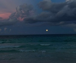 ocean, clouds, and moon image