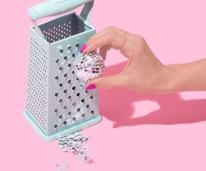 disco ball, grater, and hand image