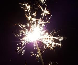 christmas, dark, and sparkler image
