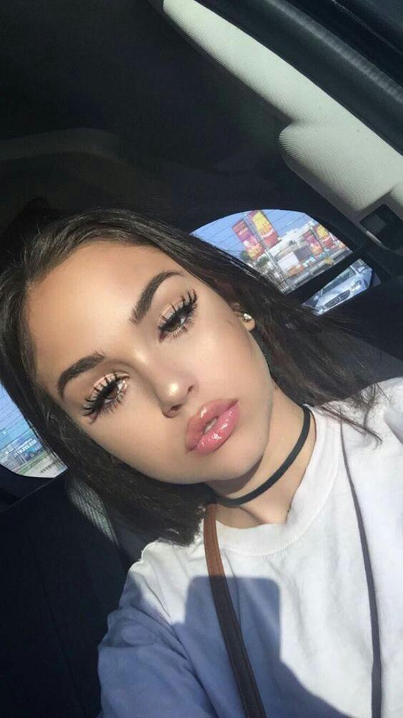 Girl In Makeup By Big Brown Eyes