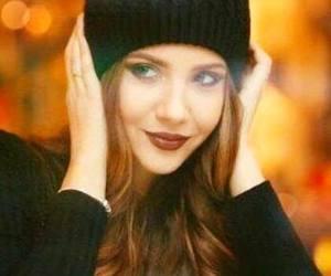 black sweater and redhead black beanie image