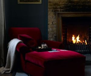 chaise lounge, interior decorating, and fireplace image