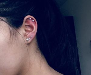 ear, lobe, and earings image