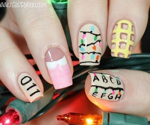 eleven, stranger things, and nail art image