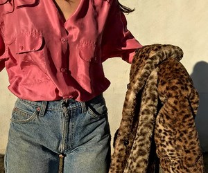 blue jeans, wavy brown hair, and pink silk shirts image