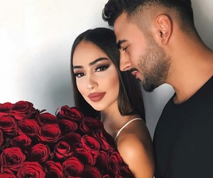 couple, red roses, and goals image