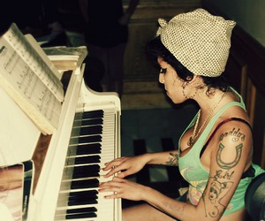 Amy Winehouse, tattoo, and piano image