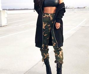 long wavy brown hair, gold layered necklace, and camo pants image