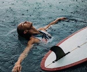 girl, rain, and surf image