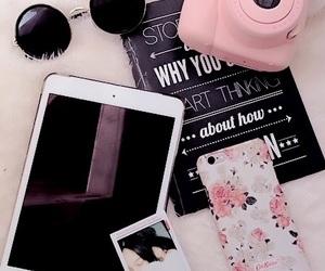 ipad, iphone, and polaroid image