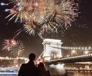 christmas, couple, and fireworks image