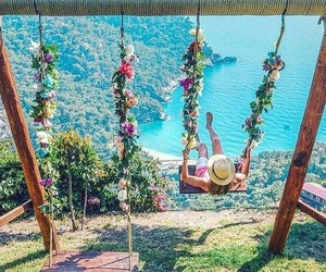 flowers, ocean, and swing image
