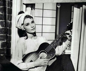 audrey hepburn, Breakfast at Tiffany's, and guitar image