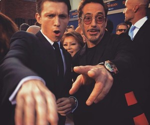 tom holland, spiderman, and iron man image