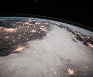 earth, space, and light image