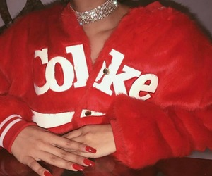 long red nails, red faux fur coats, and faux fur bomber jackets image