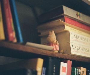 book shelf, reading, and moomin mama image