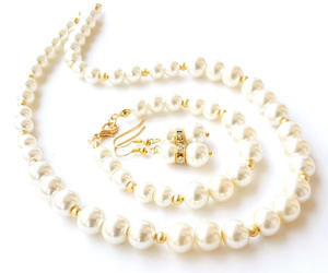 bridal necklace, pearl brACELET, and pearl earrings image
