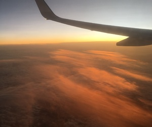 airplane, sunset, and clouds image