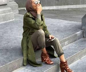hijab and olive green vest image
