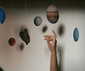 planets and hands image