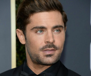 actor, black suit, and golden globes image