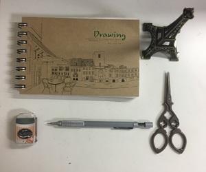 eraser, sketchbook, and scissors image
