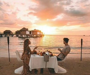 beach, couple, and dinner image