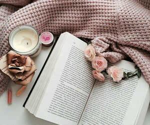 book, flowers, and candle image