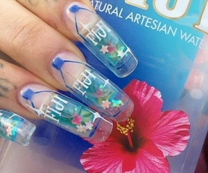 nails, flowers, and water image