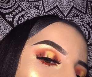 bronze, eyelashes, and eyeshadow image