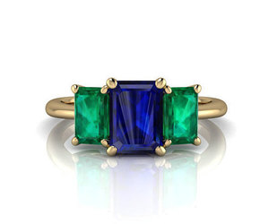 promise ring, emerald ring, and platinum ring image