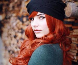 black beanie and redhead green sweater image