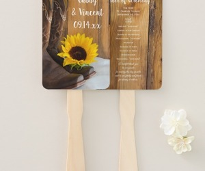 cowboy boots, sunflower, and paper fans image