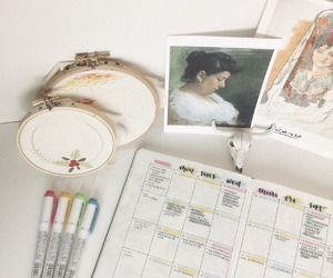 journal and stationary image
