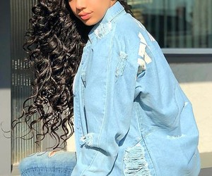 long curly brown hair, blue ripped jeans, and erica mena image