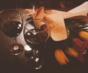 diner, flowers, and wine image