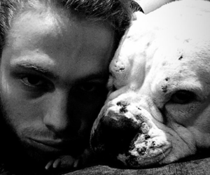 black and withe, boy, and puppy image