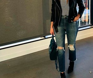 black purse, black leather jacket, and black ankle booties image