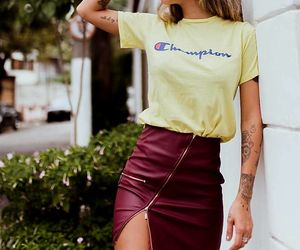 arm tattoo, leather skirts, and burgundy leather skirts image