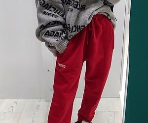 silver necklace, red sweatpants, and silver rings image
