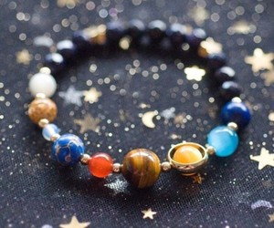 bracelet, solar system, and galaxy image