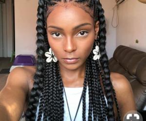 black hair, cornrows, and shell earrings image