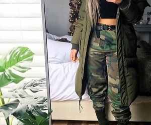 camo pants, black belts, and black ankle booties image