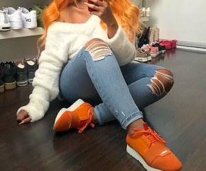 blue ripped jeans, long gold nails, and orange sneakers image