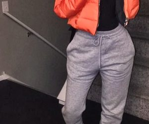grey sweatpants, short straight black hair, and silver sneakers image