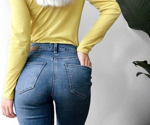 blue jeans and yellow long sleeve image
