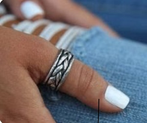 thumb ring and distressed jeans image