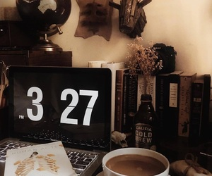 books, clock, and coffee image