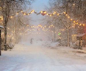 city, lights, and snow image